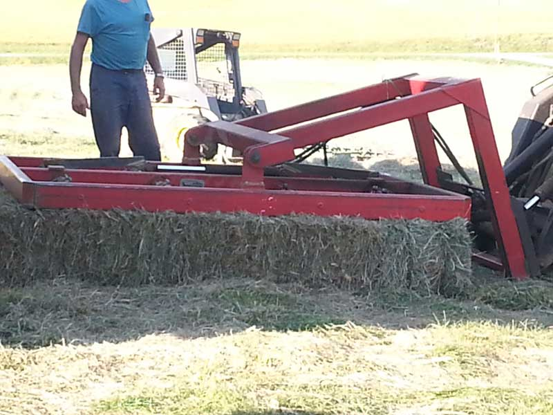 1.-Skid-Loader-picking-up-10-bales-at-a-time